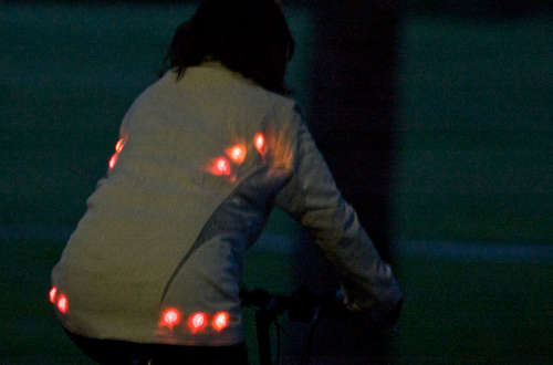 Glowing button cycling jacket