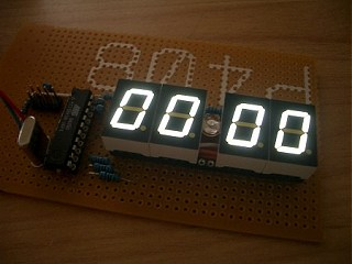 AVR digital clock with white seven segment LED display using ATtiny26 microcontroller
