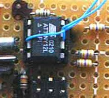 Real Time Clock/Calendar/Alarm with Interpreter for battery backed-up and battery powered operation with DS interface using ATtiny12