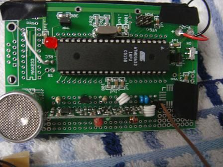 Ultrasonic spotlight tracker using Atmel mega32