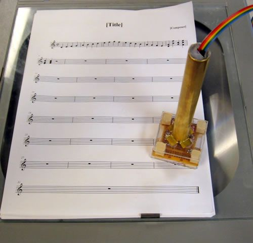 Music Wand: Real-Time Optical Scanning of Sheet Music Using Atmega32