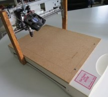 A DIY A4 Laser Engraver made from a scanner and a printer on ATmega328